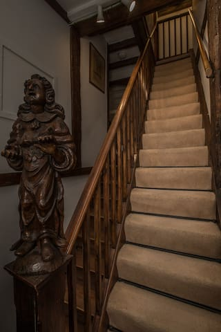 The steep staircase leading to the studio in the attic.