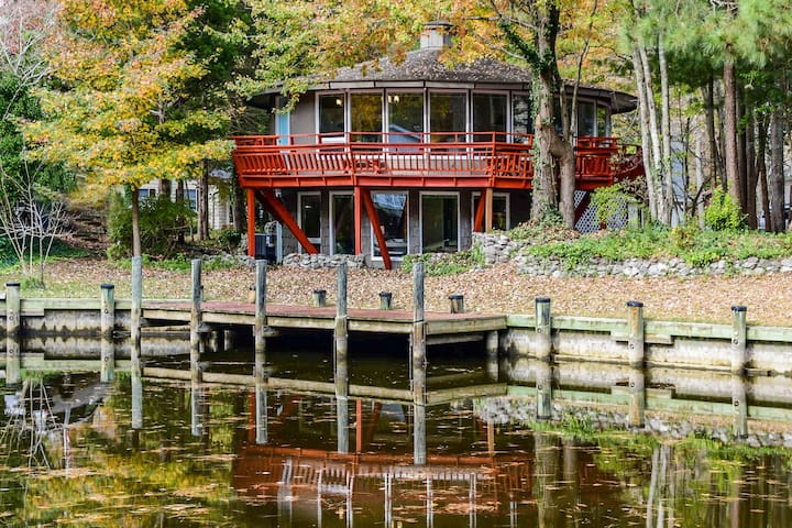 Unique waterfront home w/ shared pools, a furnished deck, & a full kitchen