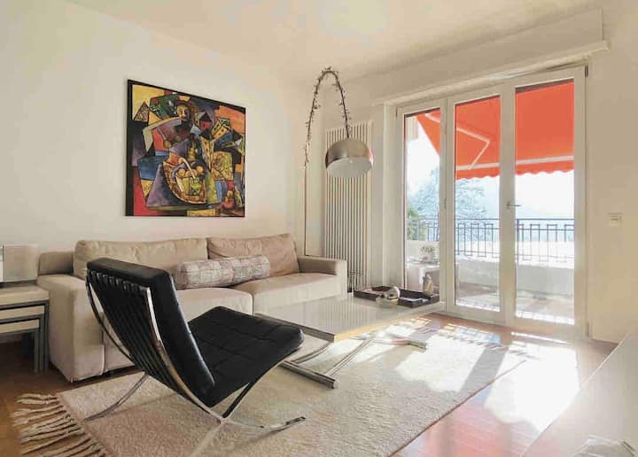 Modern apartment: Sunsets over lake Lugano