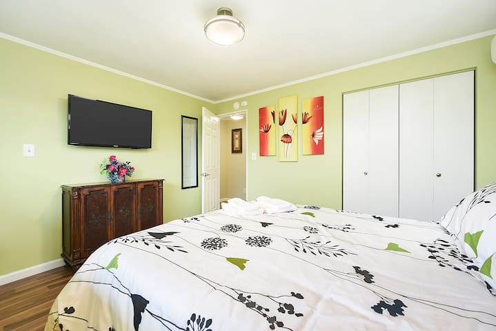 One of two colorful bedrooms on the first floor brings the feeling of flowers and trees inside.