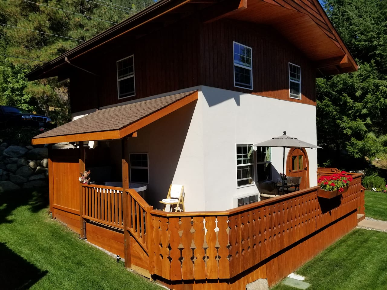 The Chalet with private deck and private 2 person Jacuzzi hot tub with bistro table and umbrella.  The Chalet has beautiful views of the Wenatchee River.