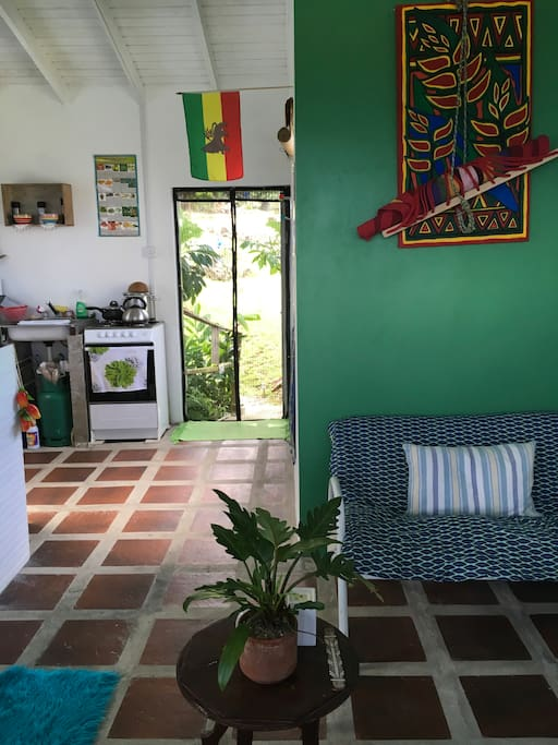 Open plan studio with private entrance , kitchen window looks out to the mountains and the balcony the other end looks out to the ocean . The studio is very light with mosquito nets when necessary own bathroom ,all facilities .