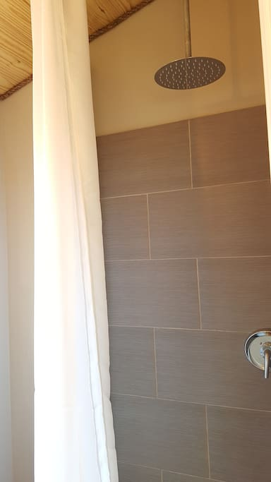 """Shower area. To give you a height reference, the shower curtain is 96"""" tall, so this over sized rain-head shower really has a relaxing cascade effect, as it is mounted so high"""