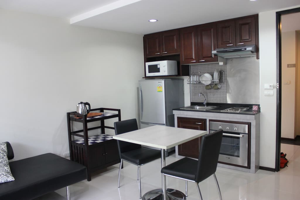 Kitchen with stove, oven, microwave, fridge, and small appliances in addition to all the plateware you'll need.