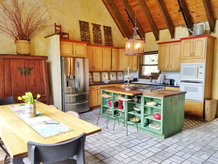Large kitchen with island and 6 person dining table
