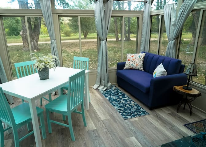 tiny home with sunroom on a beautiful campground