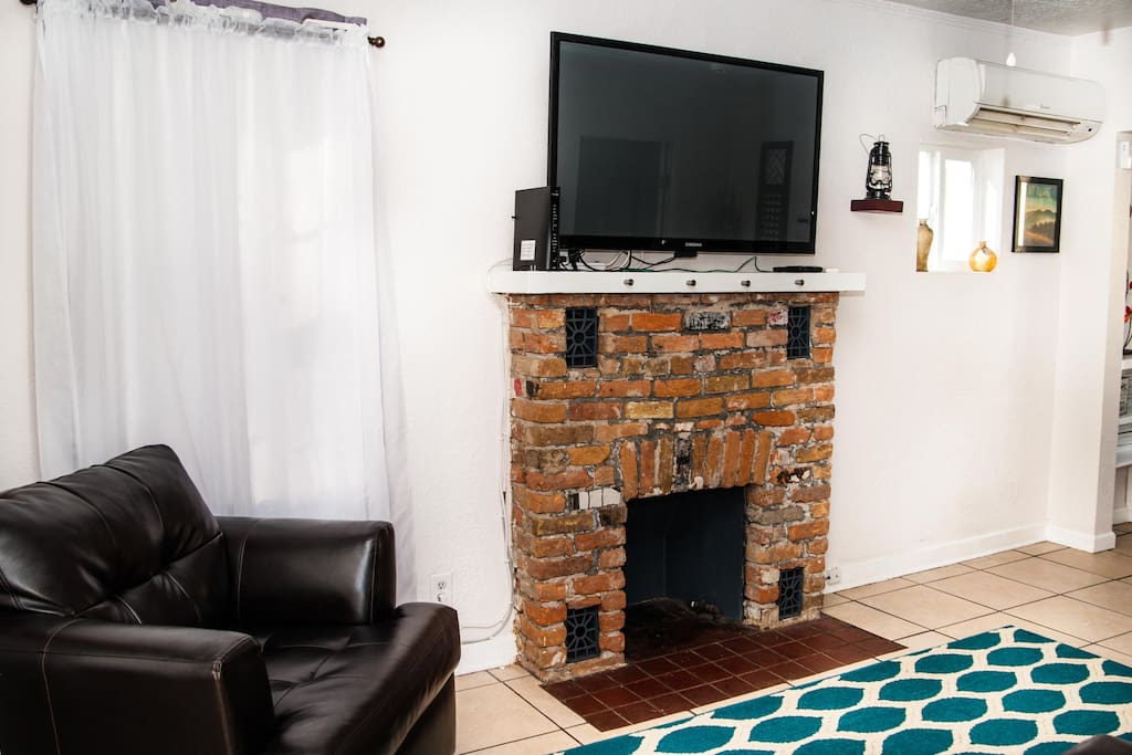 """The main living room features a queen size pull out couch and a 55"""" flatscreen TV pre setup with net flix and Amazon prime."""
