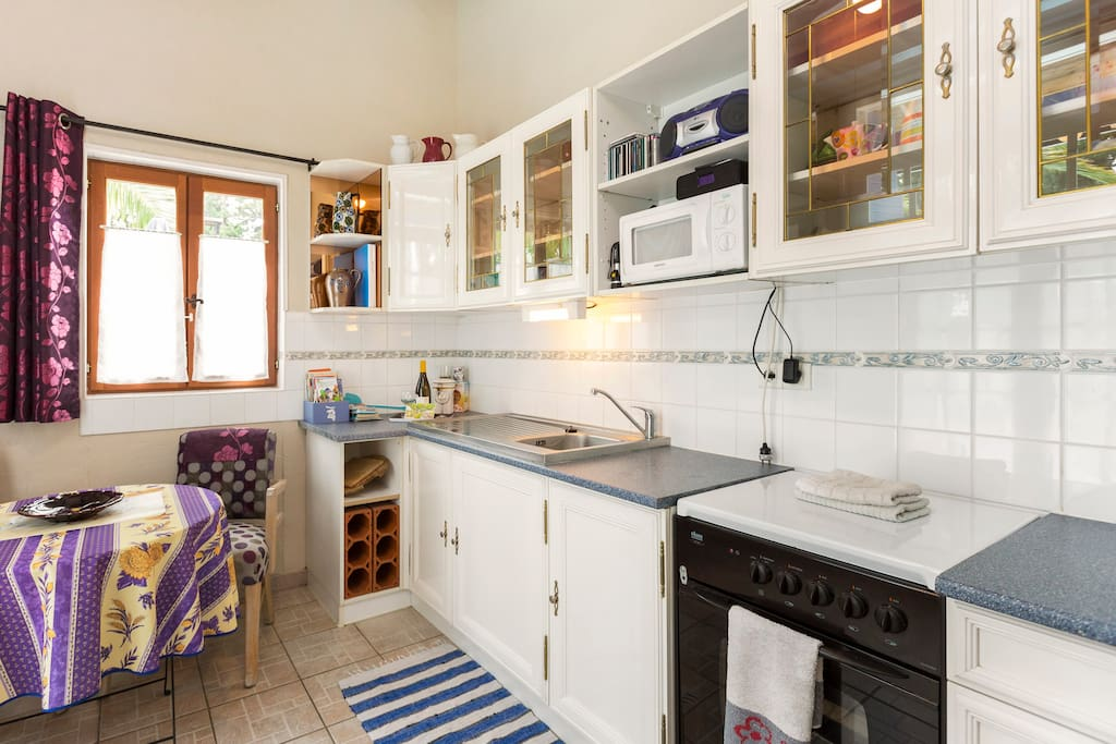 Well equipped kitchen with dining table and two chairs