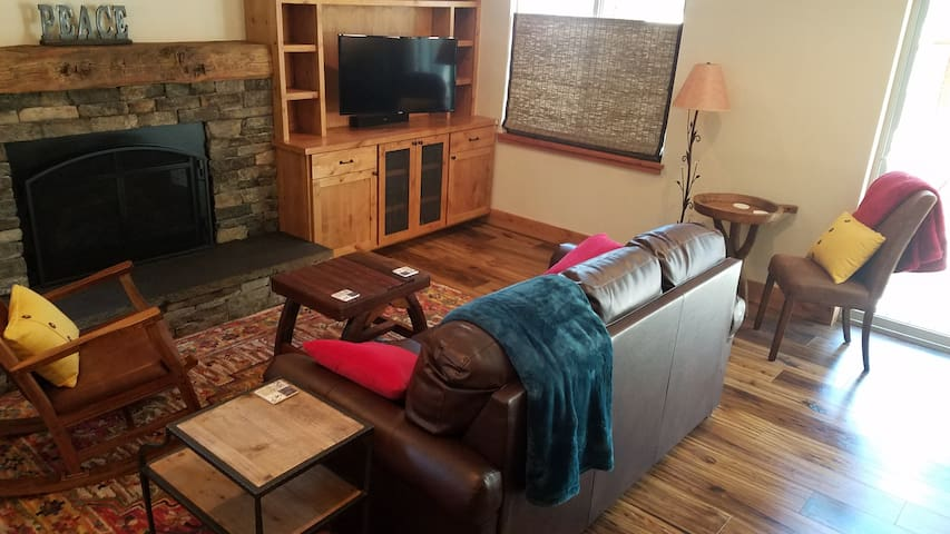 Cozy, comfy living room equipped with gas fireplace, 40in smart TV with cable, complimentary internet access and a full size sofa sleeper couch.
