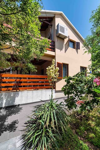 The house is surrounded with a big yard and a beautiful garden. The house has two terrace overlooking the sea.
