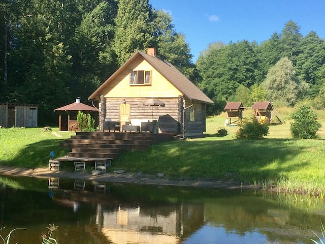 Cabin with Sauna and pond .