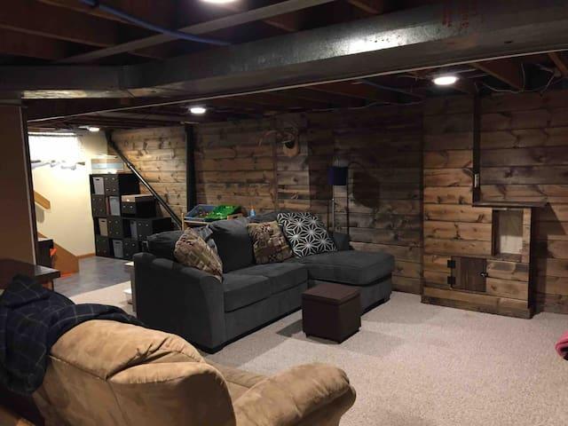 Basement living area with sleeper sofa