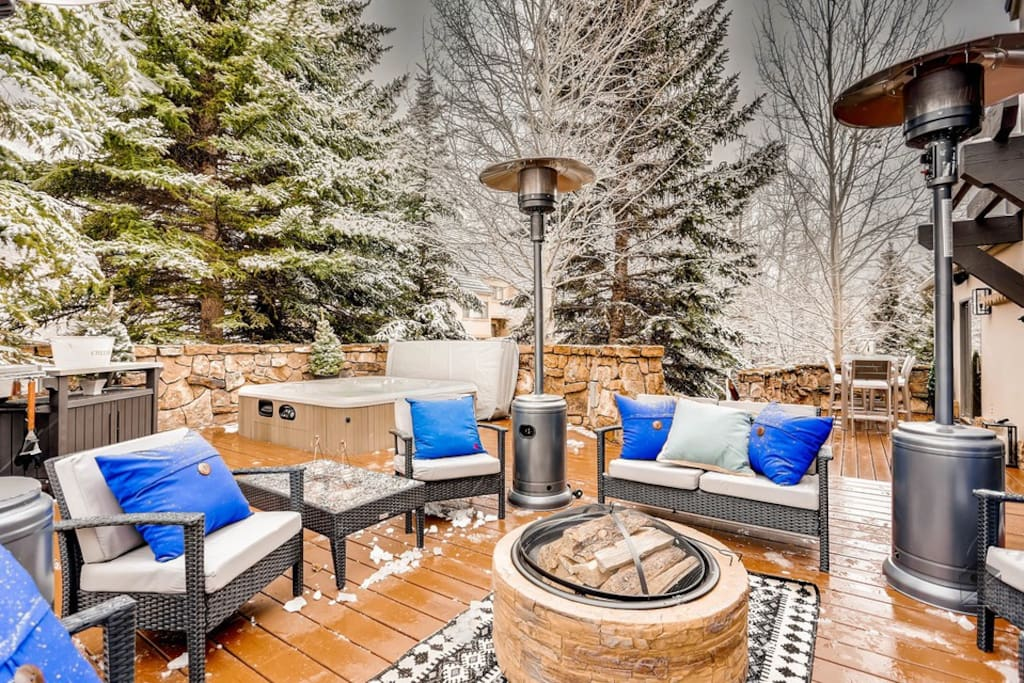 But before you head in, you just might not be able to resist getting the fire pit, hot tub or heated lamps going.