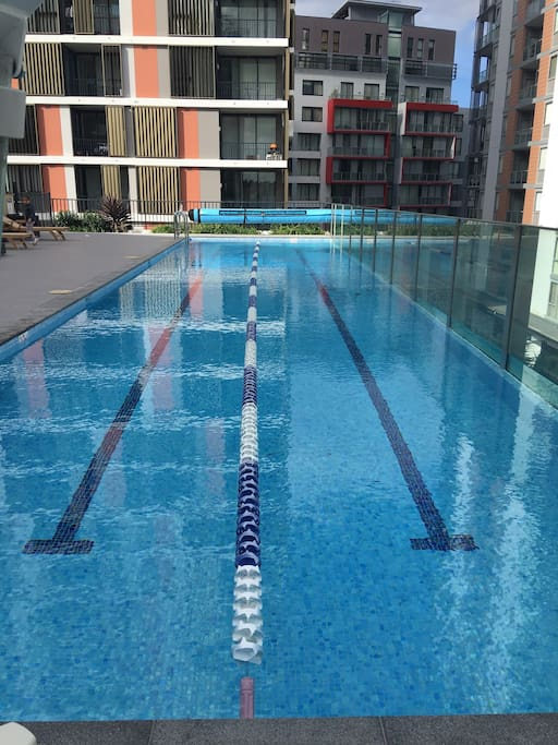 Outdoor long swimming pool for guests in the complex