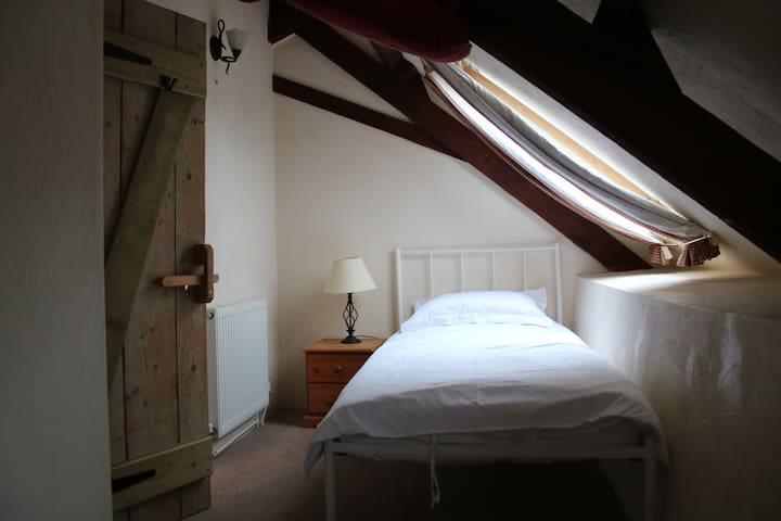 Single Bedroom with bedside table & wardrobe