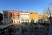 Square, Fran Center Apartments (white building), pedestrian street, Restaurants, Caffe bars