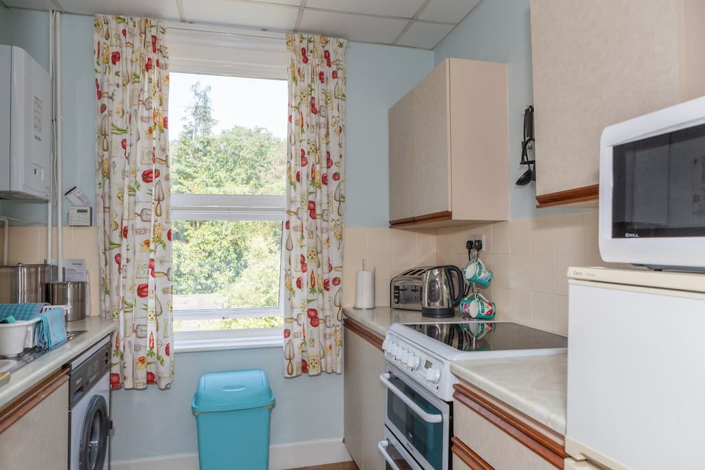 Kitchen features electric oven, microwave, fridge freezer, washing machine, kettle, toaster, iron and mini ironing board, cutlery and crockery and cooking equipment all supplied.