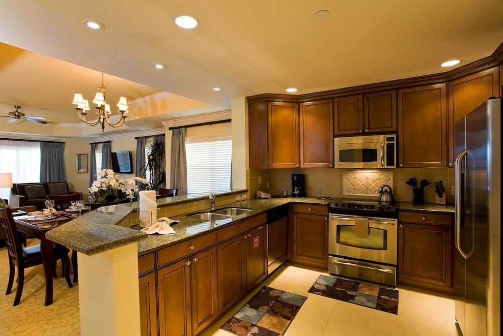 Fully equipped kitchen is complete with granite countertops