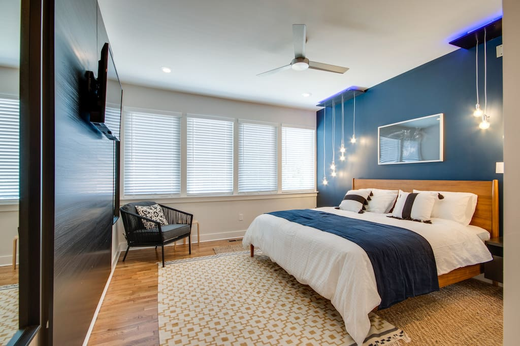 Master Suite Complete with Custom Cascade Lighting and Custom Backlight Entertainment Center (with SMART TV)