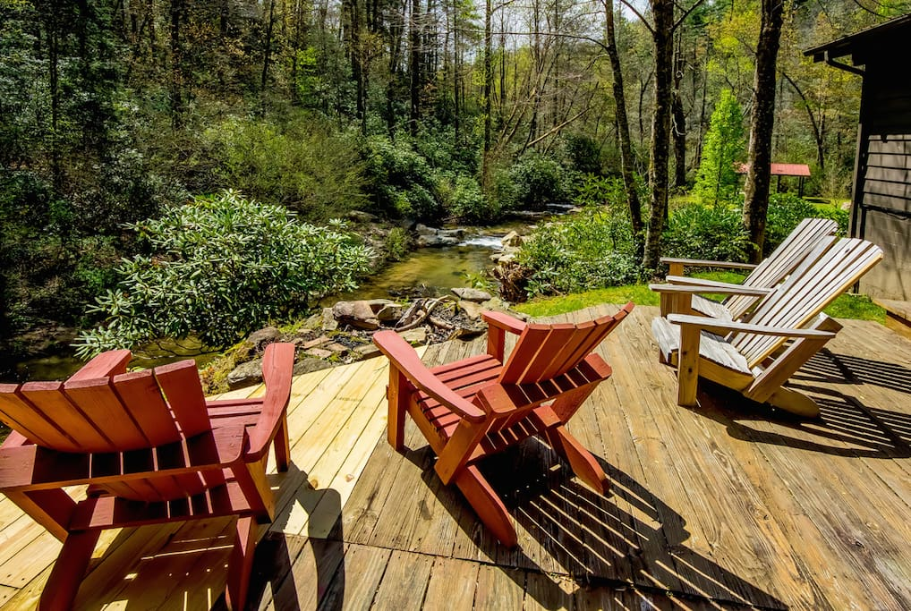 Back porch with fire pit over looking the river and swimming hole.
