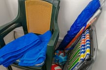 Beach towels, chairs and umbrellas for your use
