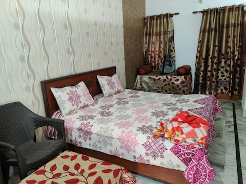Clean, airy room with double bed, in family home.