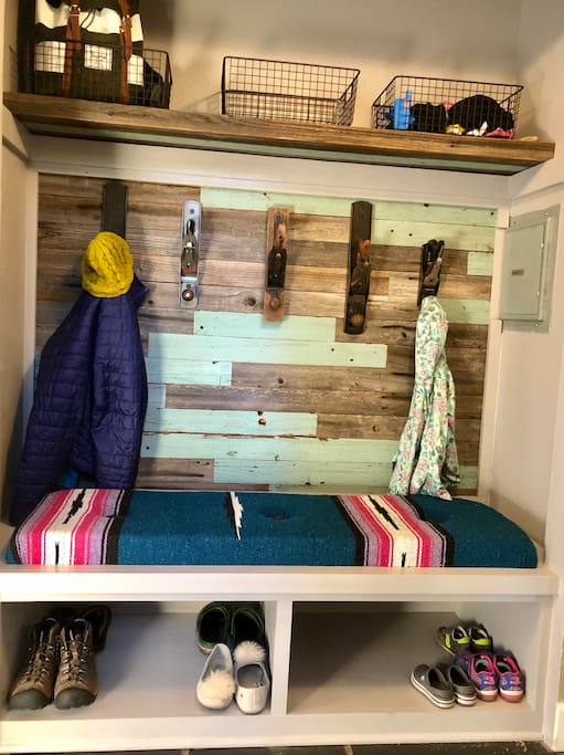 Entry station. Sit down, take your shoes off, and get comfortable. The perfect place to keep your items organized during your stay! Erik used reclaimed fence board and his dad found these cool hand planes.