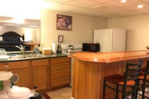 Kitchenette/bar so you can eat or socialize across from the master bedroom area (see in mirror over sink)! Full-size appliances for your convenience.