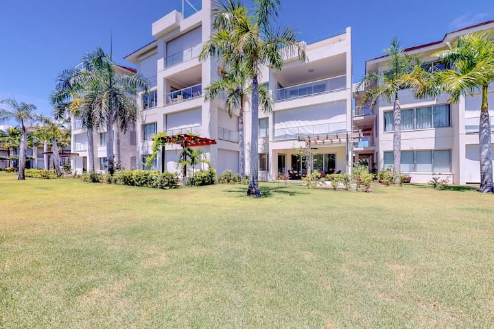 Modern golf-course-front apartment w/ shaded terrace & resort pool!