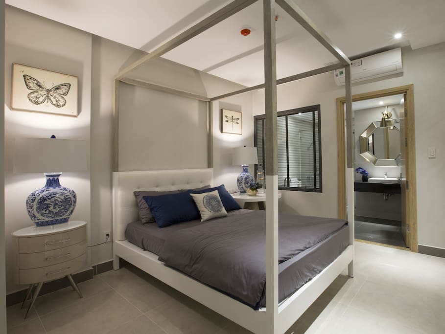 A master bedroom with a double bed and its own bathroom with shower