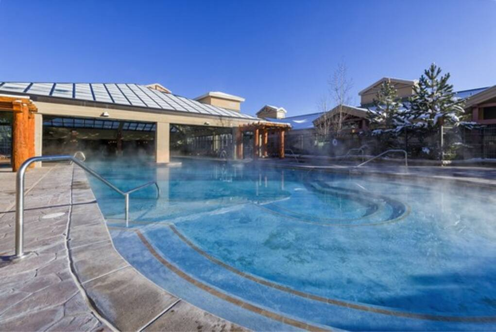 Indoor outdoor pool with two out door hot tubs.