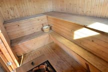 Inside the sauna, with the obligatory water bucket for splashing of the walls (and sometimes each other:)