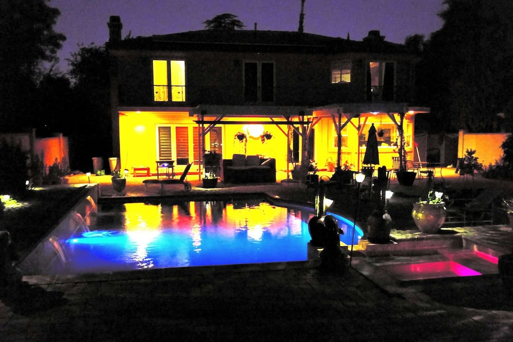 Backyard showing pool lights and waterfalls