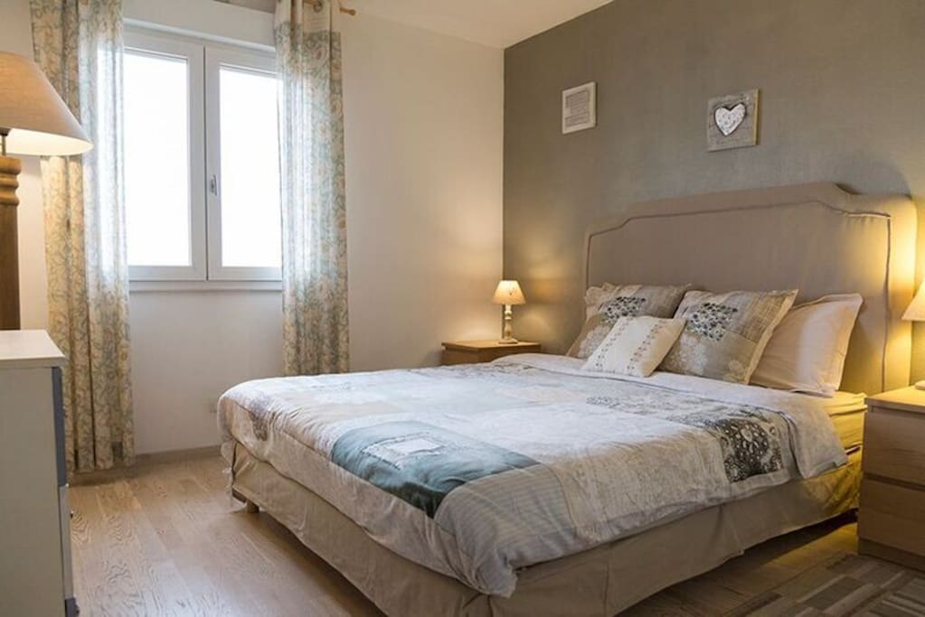 Main bedroom with a queen sized bed ( 160 cm)