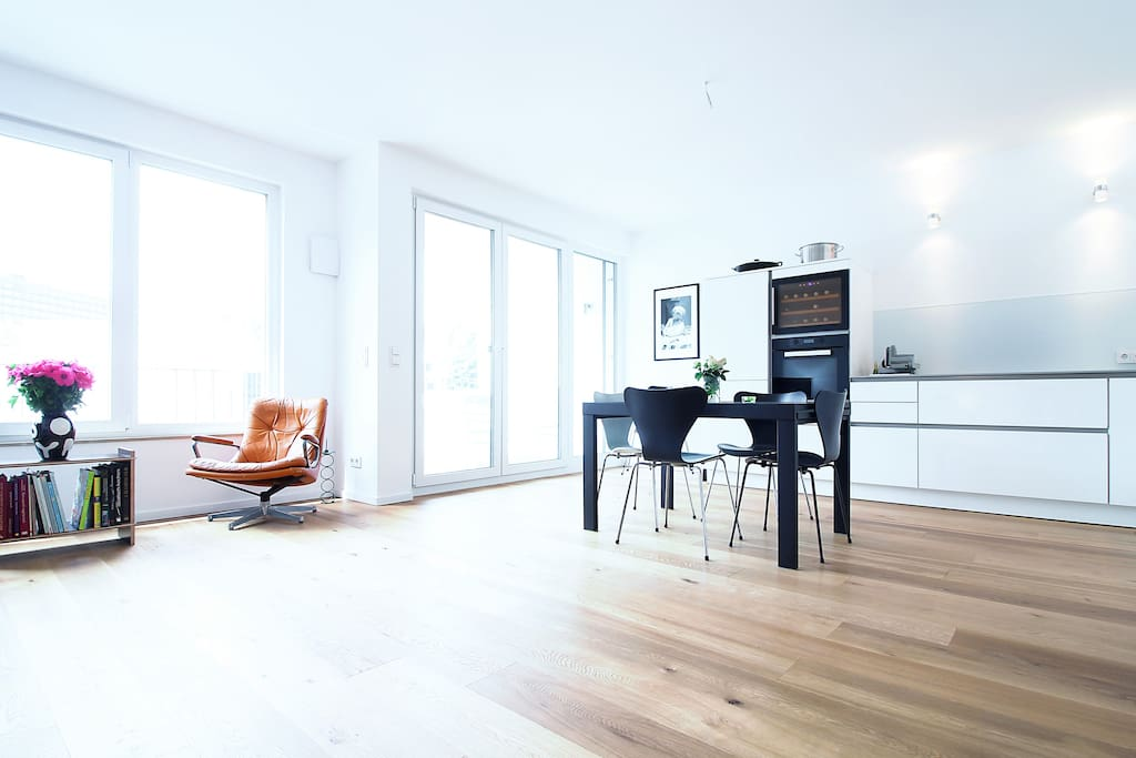 The kitchen is integrated into the living room and includes a dining table for up to 4 persons.