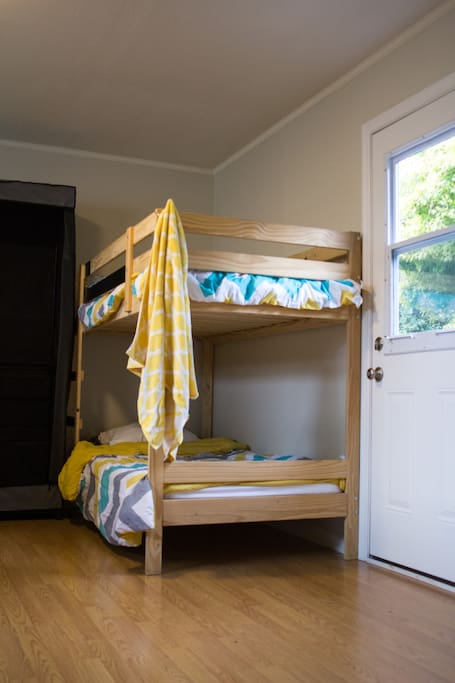 Residents sleep in four-person and six-person bedrooms. Each bunk comes with underbed storage bins, your own half-height closet space, and additional suitcase storage. All upper bunks have a bedside-table space.