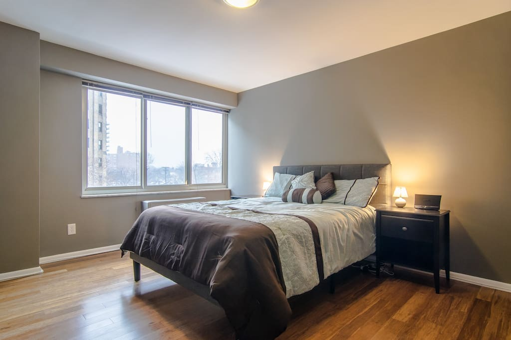 Wake up to views of Lake Erie in this spacious bedroom with 2 large closets, a new queen bed, 2 end tables, and a dresser.