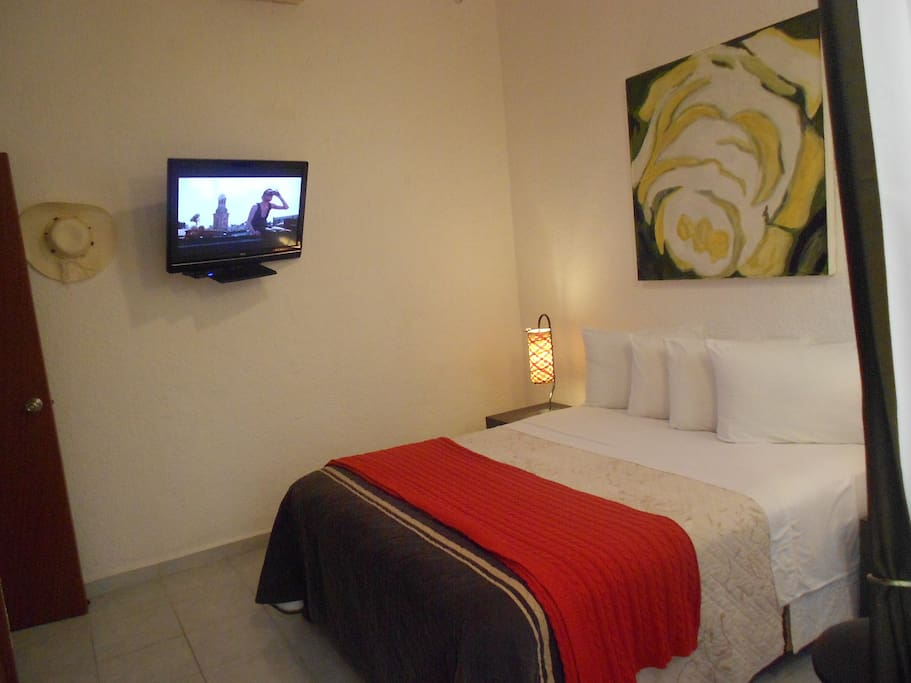 """Bedroom with queen size bed and 32""""  TV"""
