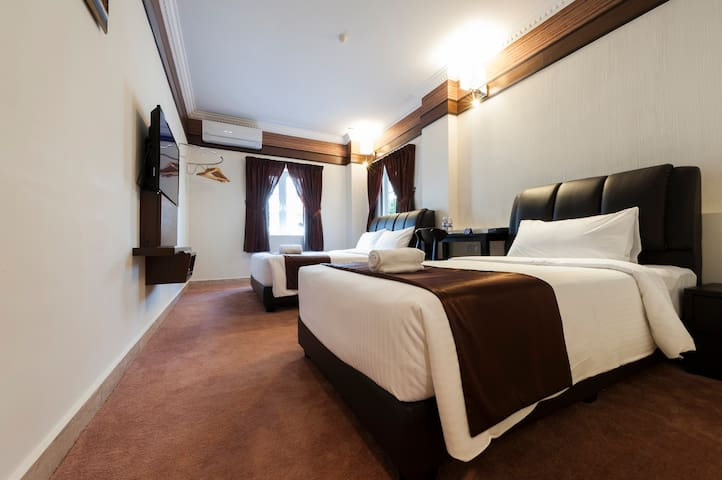 Family Room #102 (Seriental Hotel)