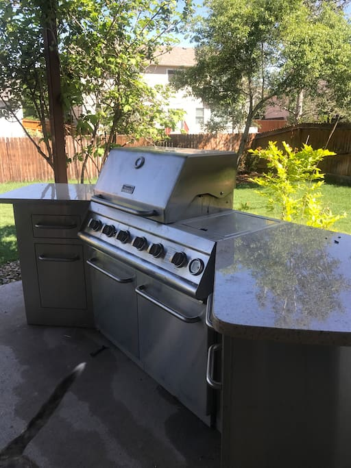 Complete access to built in outdoor grill in private backyard.