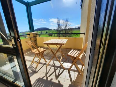 Séjour au calme avec soleil levant en terrasse