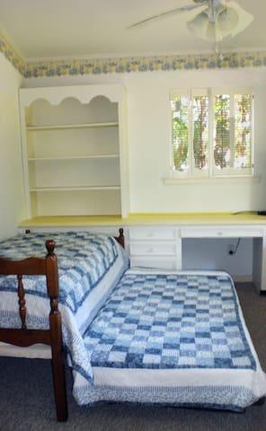 Yellow room: Trundle bed is versatile.