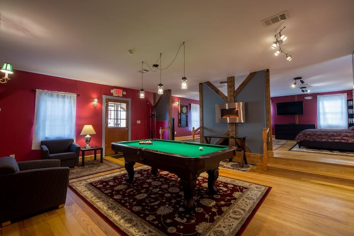 Bedroom and lower pool table/entrance are one open space