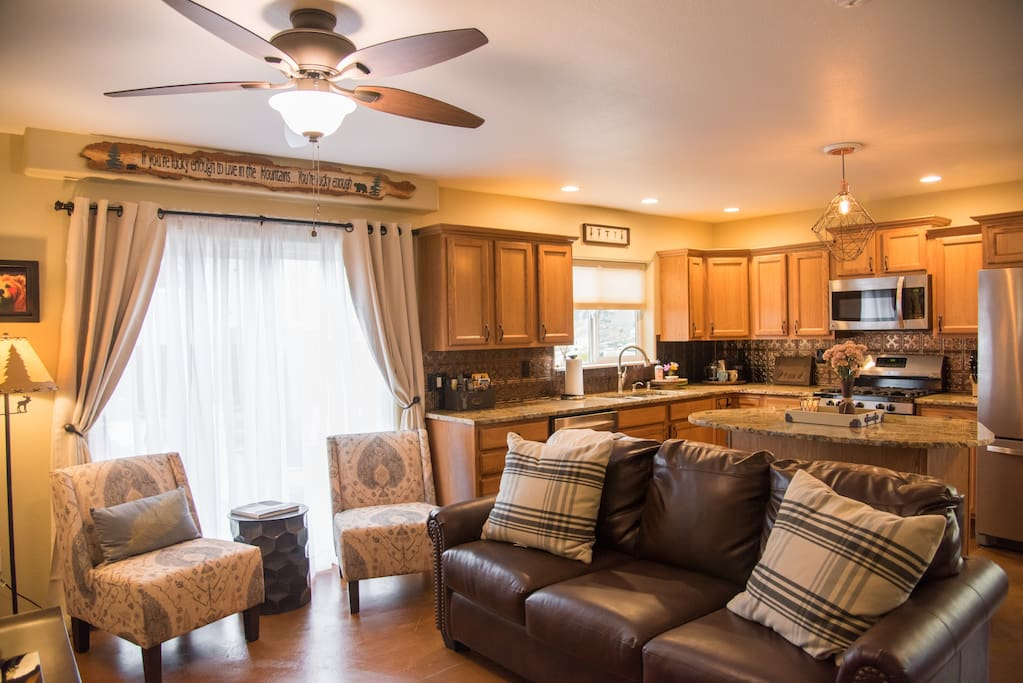 Open kitchen/living/dining area. Queen sleeper sofa with memory foam mattress in the living room.