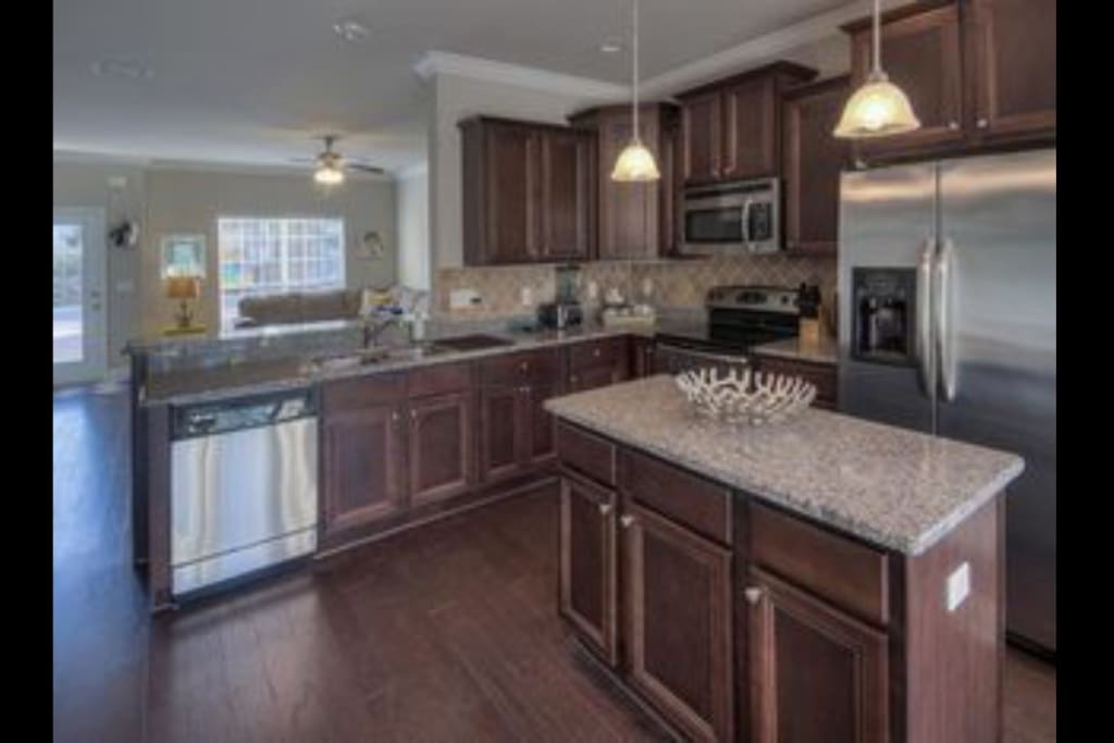 Large island and fully stocked kitchen. Even has an espresso machine and 10 cup coffee maker.