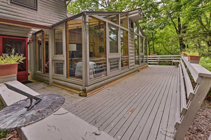 Featuring an expansive deck surrounded by lush greenery, this home makes it easy to reconnect with nature.