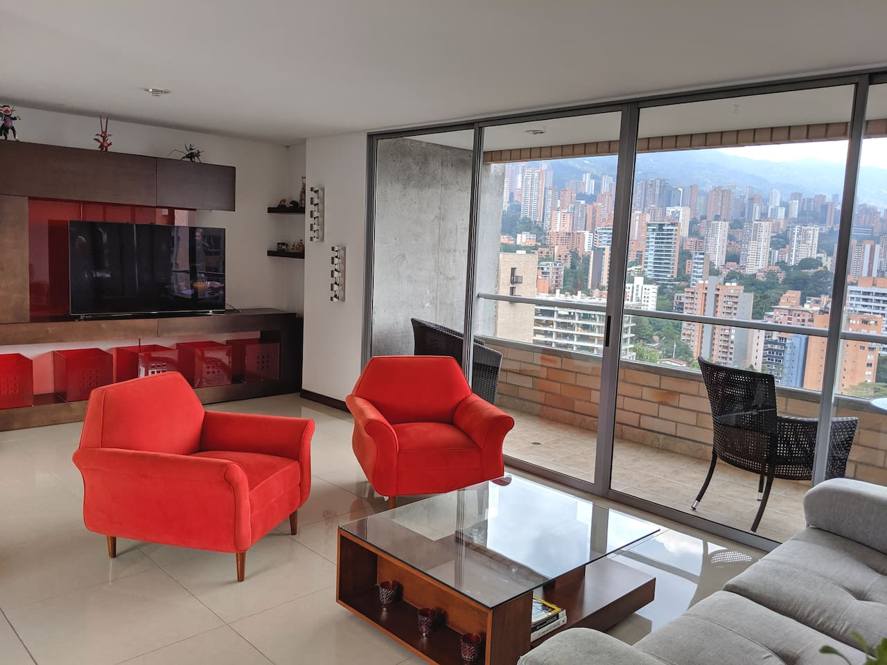 """Living area with an unobstructed view . 53"""" smart TV"""
