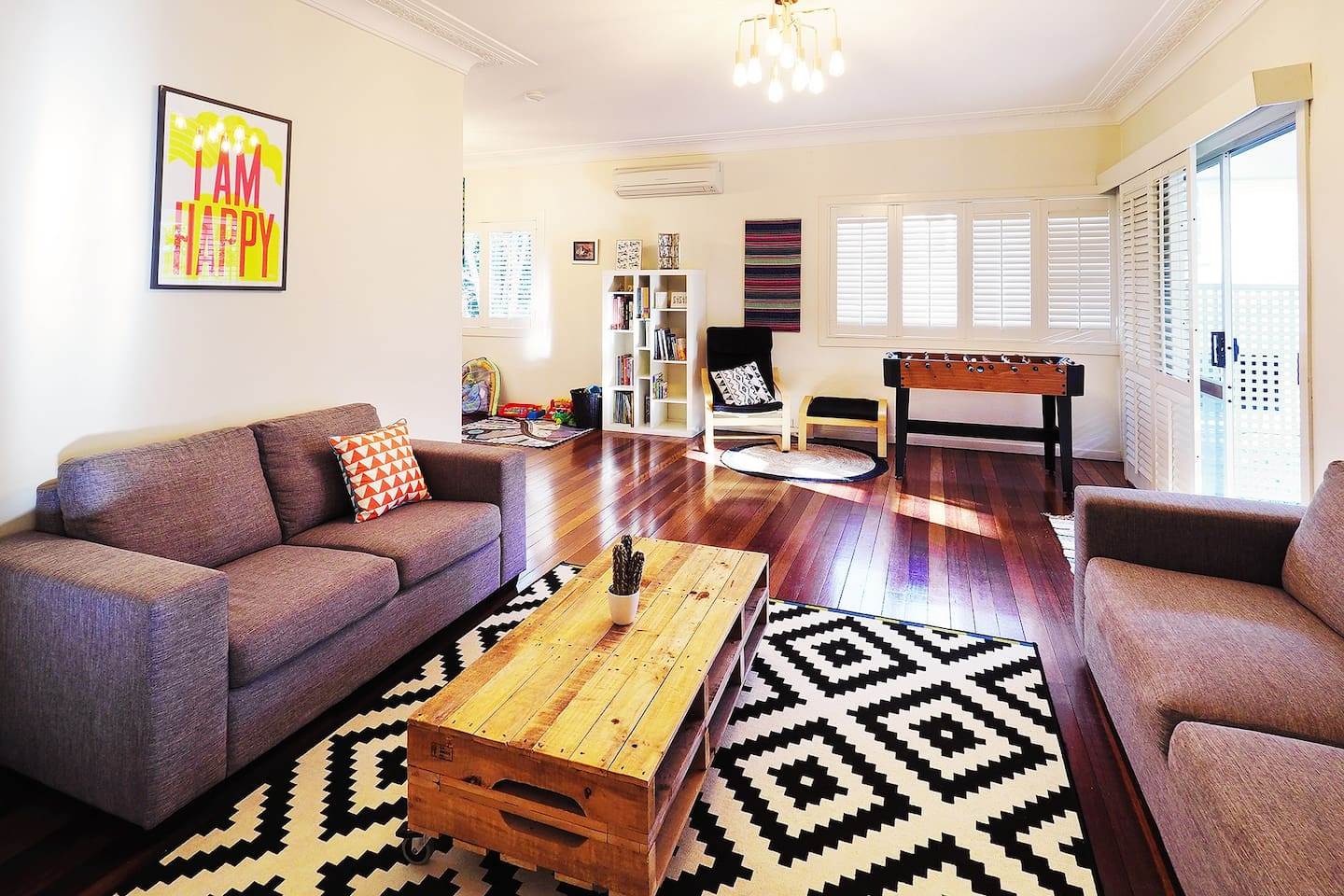 The front air-conditioned living room with two comfy lounges!