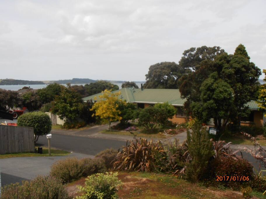 The front of the flat with Kawau Bay beyond.