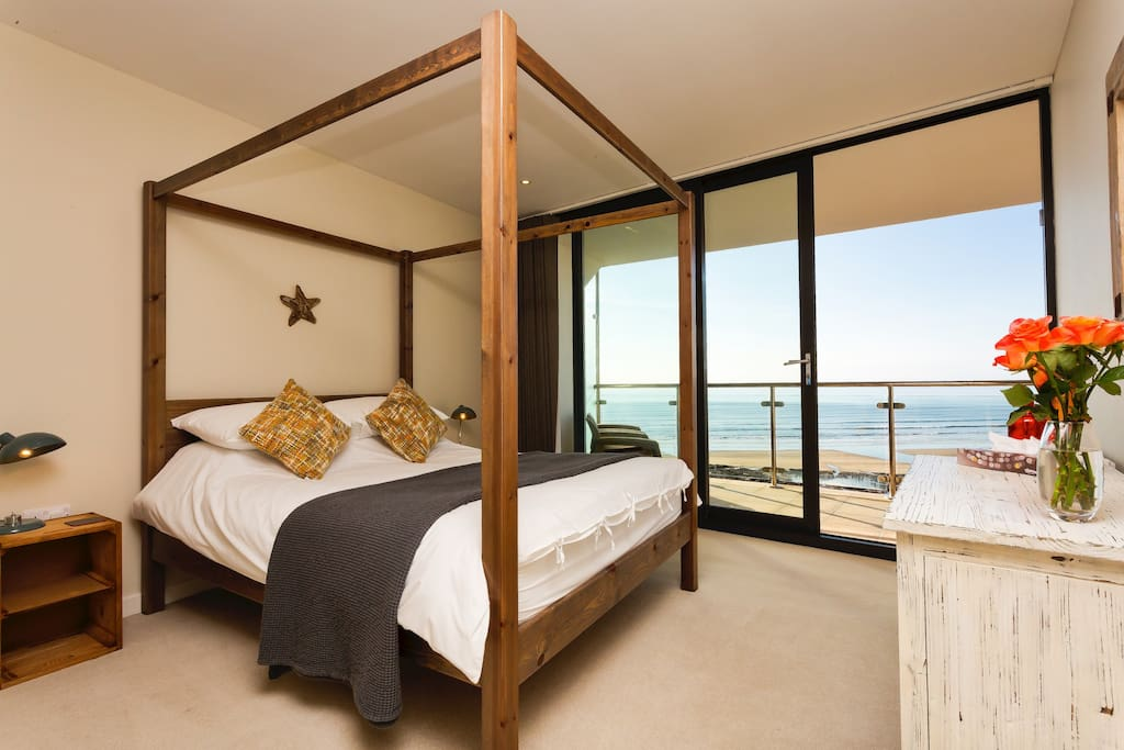 Master bedroom with luxury kingsize four poster bed